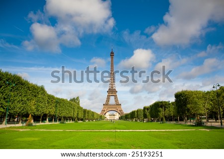 The Eiffel Tower in the morning with some clouds in the sky. Summer time - stock photo