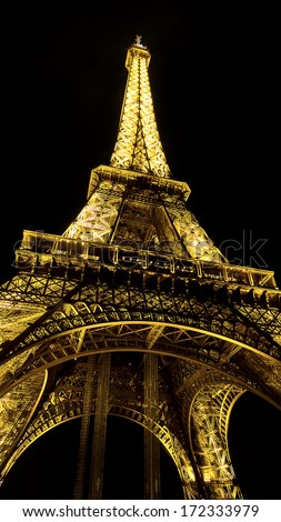 The Eiffel Tower (La Tour Eiffel) is an iron lattice tower located on the Champ de Mars in Paris - stock photo