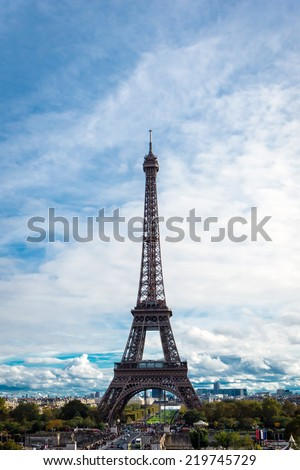The Eiffel Tower (Le Tour Eifel) as seen from The Trocadero, with cloudy Paris skies - stock photo