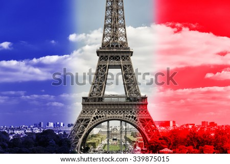 The Eiffel tower on French flag background in Paris - stock photo