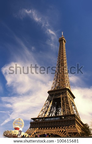The Eiffel Tower with a cloudy sky background