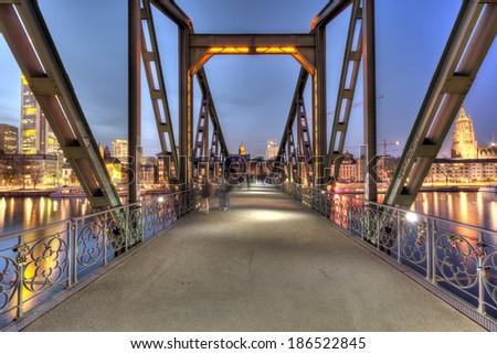 The Eisernersteg pedestrian bridge across the River Main in Frankfurt. - stock photo