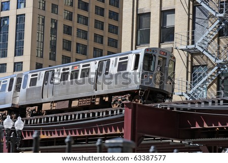 The El. Overhead commuter train in Chicago.  Chicago's elevated commuter train. - stock photo