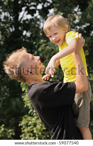 the elder brother keep in hands of the younger brother - stock photo