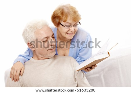 The elderly couple reads the book on a white background - stock photo