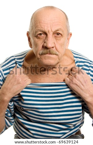 The elderly man in a stripped vest - stock photo