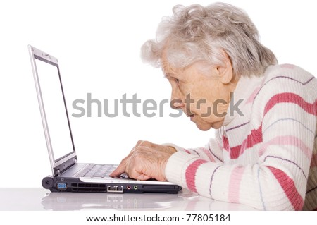 The elderly woman at the computer - stock photo