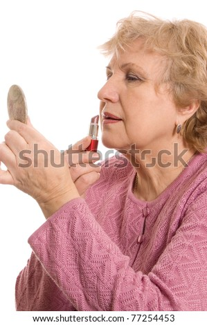 The elderly woman does a make-up isolated - stock photo