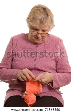 The elderly woman knits isolated on white - stock photo
