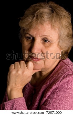 The elderly woman on black background - stock photo