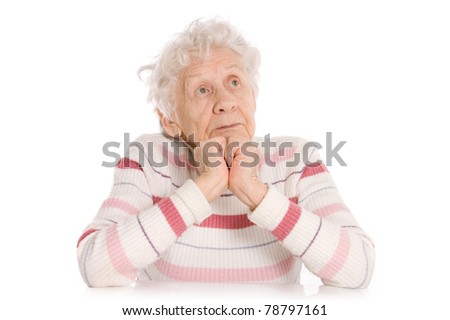 The elderly woman reads the book - stock photo