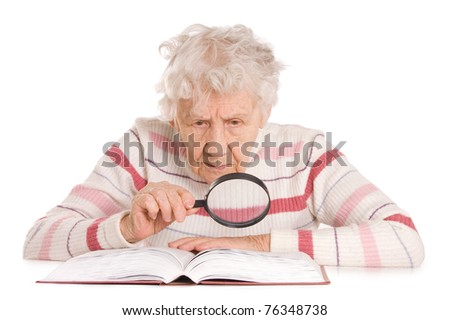 The elderly woman reads the book isolated - stock photo