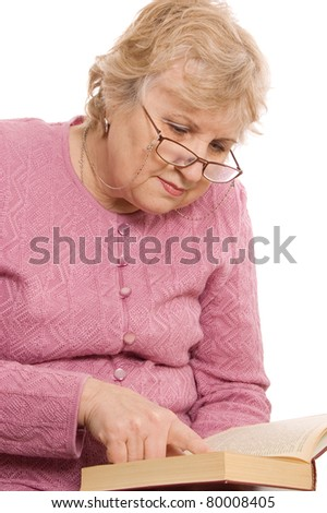 The elderly woman reads the book isolated