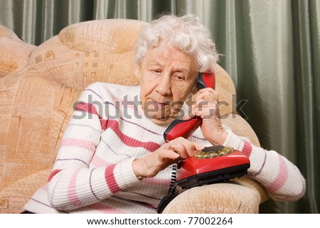 The elderly woman speaks on phone - stock photo