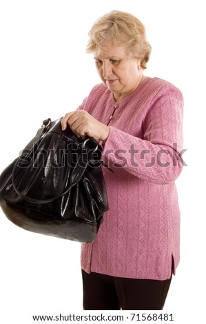 The elderly woman with a black bag - stock photo