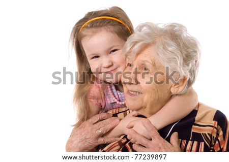 The elderly woman with grand daughter - stock photo