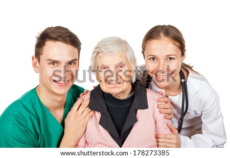 The elderly woman with her helpful caregivers