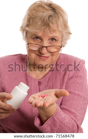 The elderly woman with tablets - stock photo
