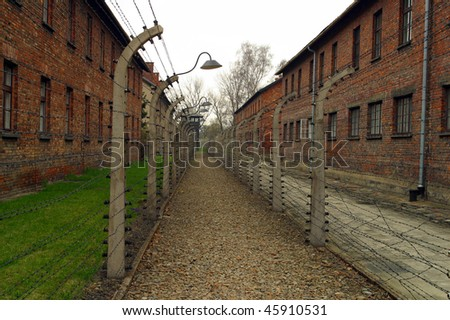 The electric fence at Auschwitz concentration camp Oswiecim Pola - stock photo