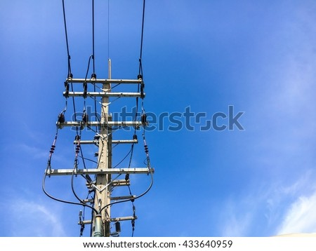 The electric high voltage pole with transmission line,insulators,drop out fuse and lightning arrestor located in the transformer yard before down to low voltage to using. - stock photo