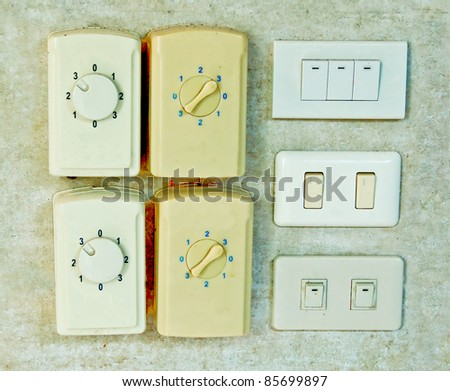 The Electrical switch and plug on wall - stock photo