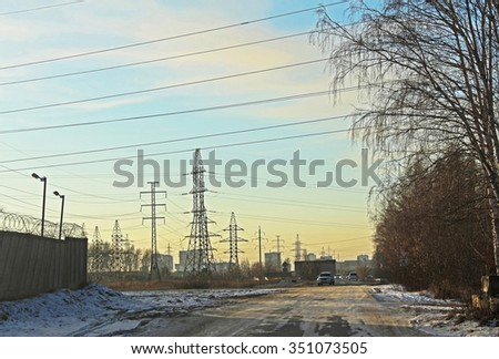 The electrical transmission line near the residential area - stock photo