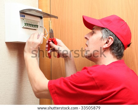 The electrician establishes a fixture - stock photo