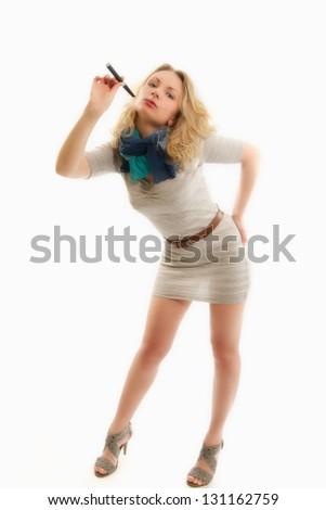 The electronic cigarette in the hands of sexual blondes - stock photo