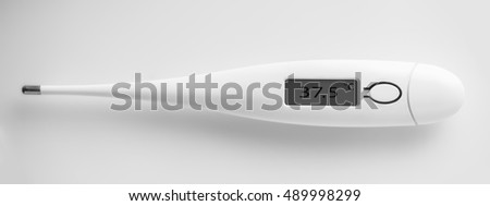 the electronic thermometer closeup on a white background