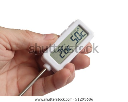 The electronic thermometer in a hand close up on a white background is isolated