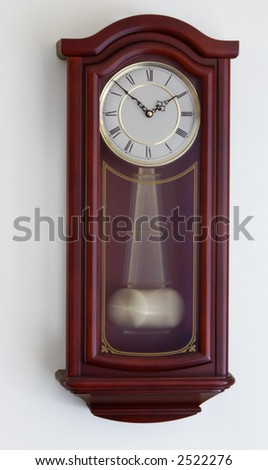 The elegant and graceful pendulum clock - stock photo