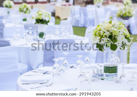 The elegant dinner table on the beach - stock photo