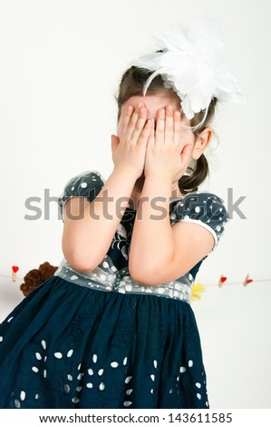 The elegant girl shut the face with the hands - stock photo