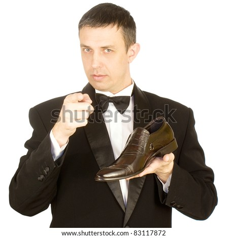 The elegant man in a classical tuxedo prefers the best model of footwear - stock photo
