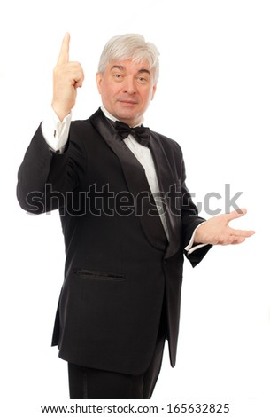 The elegant man in a tuxedo on a white background.
