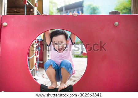 The elementary aged child in the playground - stock photo