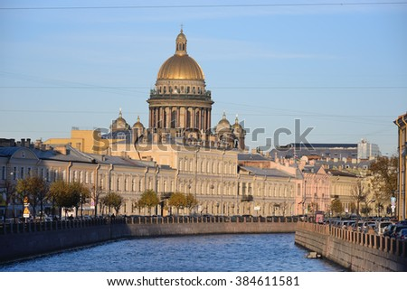 The embankment of the river Moika, St. Isaac's Cathedral at sunset in autumn in St. Petersburg