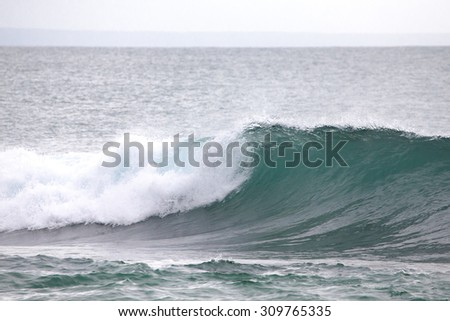 The emerging wave of the sea near the coast. - stock photo