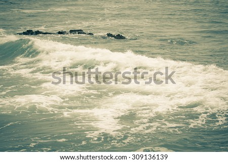 The emerging wave of the sea near the coast. Tinted - stock photo