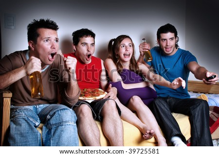 The emotional fans  watching TV - stock photo