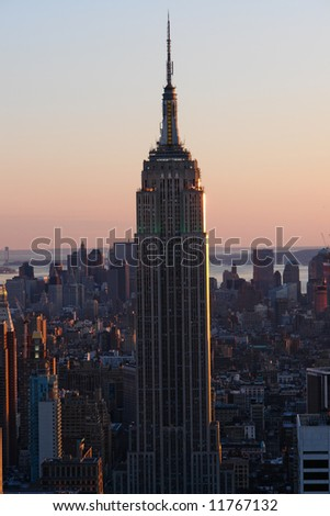 The Empire state building in New York at sunset time.