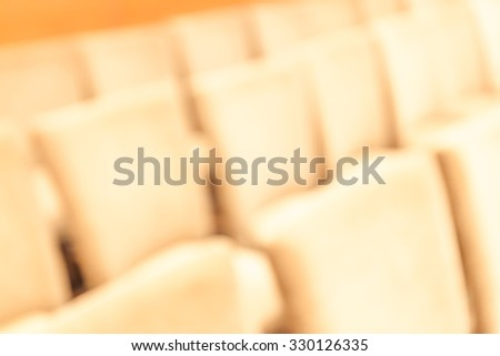 The empty auditorium seat abstract blurred background. - stock photo