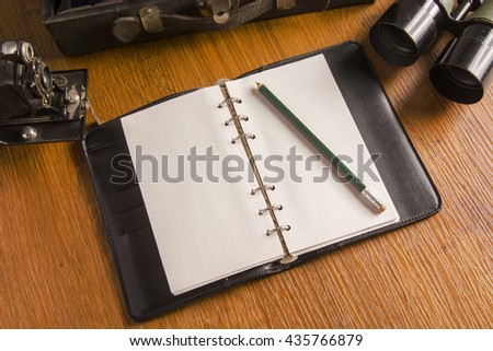 The empty note book on wood table - stock photo