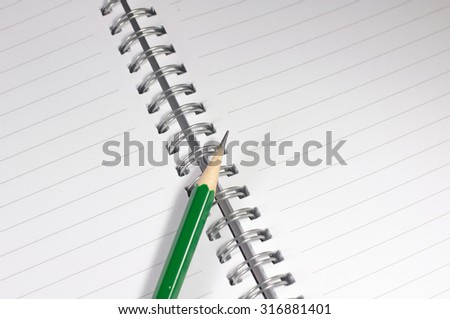 the empty notebook with green pencil, ready to note or work - stock photo