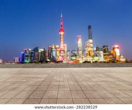 The empty square in front of the  fuzzy modern city, Shanghai, China  - stock photo