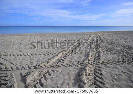 The empty tropical beach of Varadero in Cuba on a beautiful summer morning. Varadero is one of the top destination in Cuba to enjoy an all inclusive vacation. - stock photo