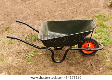 The empty wheelbarrow in a garden.
