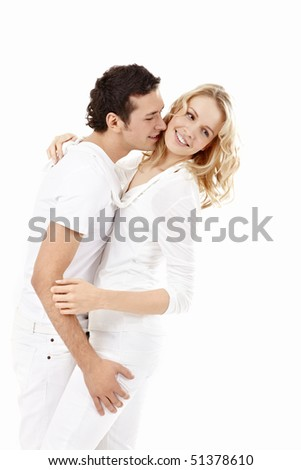 The enamoured man embraces the attractive girl - stock photo
