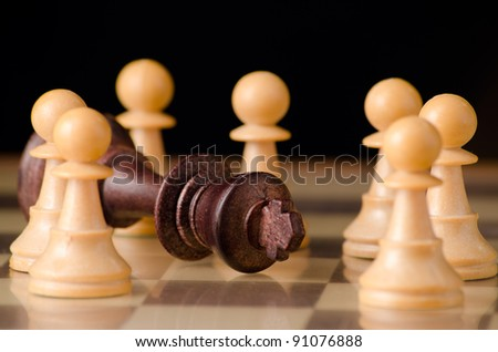 The end of a tyranny symbolized with chess pieces - stock photo