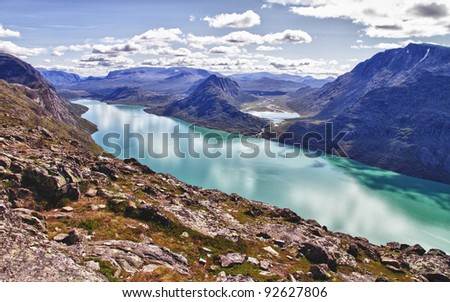 The end of the lake Gjende in Norway. Start of the famous Bessegen hike in Jotunheim National Park, Norway - stock photo